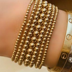 Gold tone metal bead bracelet